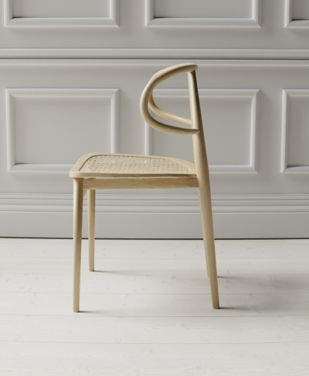 Curve chair in panelled room
